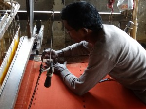 a weaver creating a brocade edge