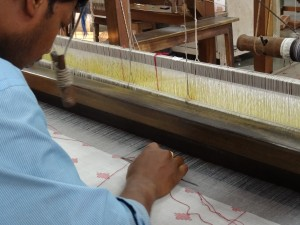 picking out warp threads for the jamdani motif
